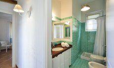 Bagno verde con doccia Li Conchi 9, Cala Sinzias